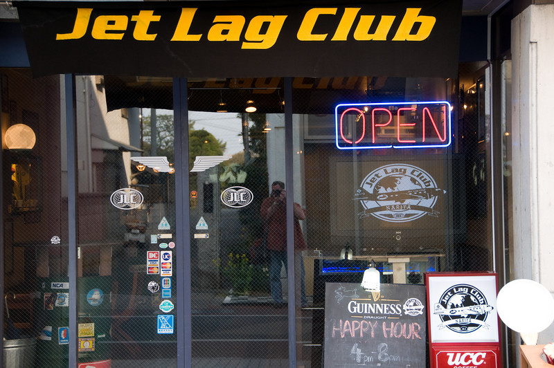 "The Jet Lag Club.  I did have to go in and have a beer.  Yep, Guinness was also $8 here.  I also couldn't help but to notice the handsome fella with the camera that they had painted on their front door.  This was a quirky little place that ""catered"" to the aircrew crowd.  While I wasn't there late, I didn't see any aircrew folks in attendance.  I think that most of them try the other places."