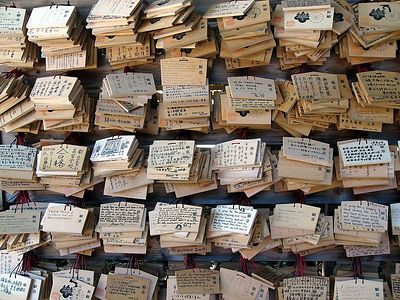 Hopes and well wishes written on wooden slates.