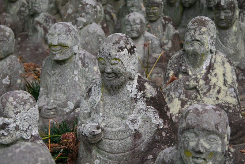 Centuries old buddhas laugh, cry, and stare back at you in the town of Usa, Japan