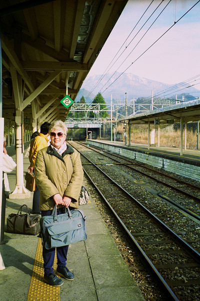 My mother patiently waiting for a train bound for somewhere.
