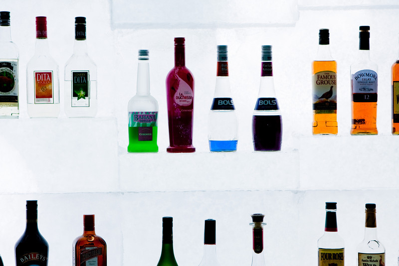 A colourful display of assorted liqueurs cooled and shelved by large cut blocks of ice teken from the lake.