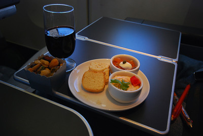 Business class travel to Japan is a non-stop foodfest.  Dinner begins with this appetizer of hummus and salmon salsa on crackers, and an assortment of nuts (which are refilled if you want).
