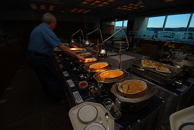 """The """"Top of Hanno"""" restaurant features a breakfast buffet. Notice the first item, an interesting translation of """"hash brown.""""  The egg dishes beyond that are woefully undercooked, as is the bacon."""