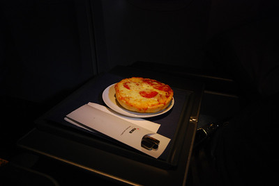 About six hours after dinner, the flight attendants will offer anyone who isn't sleeping a mid-flight snack. Oliver and I chose the pepperoni pizza.