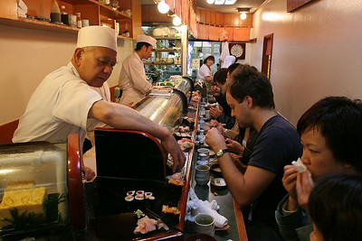 One of the tiny sushi restaurant lining the periphery of the Tsukiji fish market in Tokyo.  Best sushi in the world!