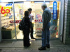 On the way to dinner, Sachiko sweet-talks a closed shopkeeper to fix Bob's glasses. Everything in Tokyo seems to close at 8 PM.