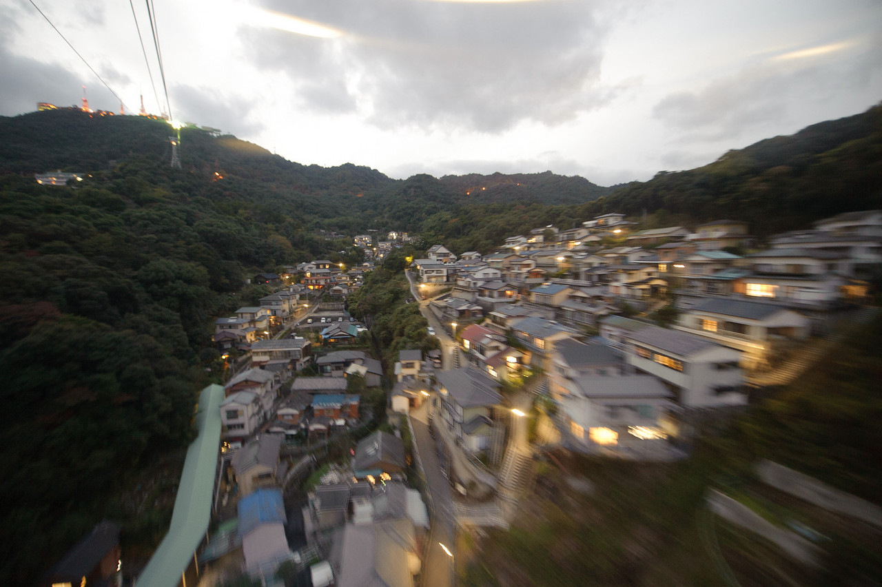 Heading up the Ropeway to the viewing platform. We were a little late, so the sky is just about perfect right here for deep blue dusk shots. Here I've dialed up the white balance to 20,000K to illuminate this neighborhood.