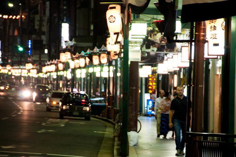 Shijo-dori, the main commercial street in Kyoto, at night.