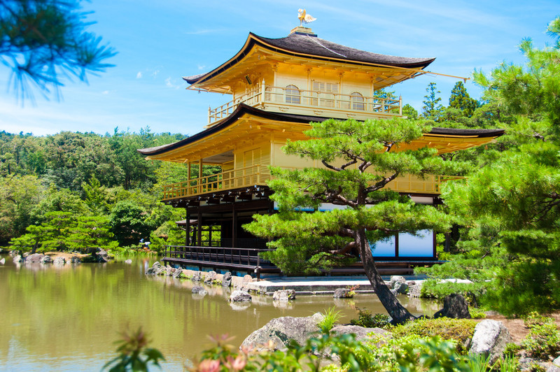 The Temple of the Golden Pavilion (kinkaku-ji) in Kyoto, sometimes found in screensavers and desktop backgrounds.  The top two levels are finished entirely in gold (it's not paint).  This pavilion was built in the 1100's as a summer resort, then converted into a Buddhist temple in 1398.