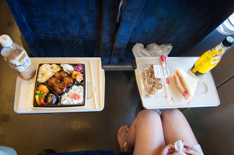 As is the way it's done on the train, we stopped by a department store and bought boxed lunches for the train (eki-ben).  I went for a chinese combination box, krista got a salmon-and-cream-cheese sandwhich.  The boxes are affordable (~700 yen) and very attractively arranged.