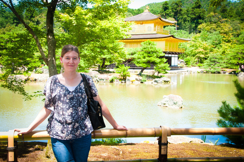 Krista standing near the brightly-lit Golden Pavilion.