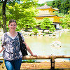 Krista standing near the brightly-lit Golden Pavilion.