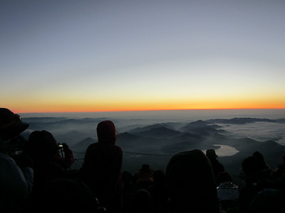 After waking up 2am and hiking up Mt Fuji in the dark while following the brilliant trail of headlamps up the mountain -- we finally arriving at the summit in time for sunrise.  Hundreds of people waiting eagerly for the sunrise.