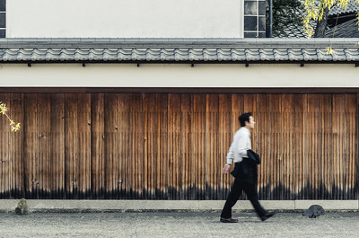 Man Walking Through Kurashiki Bikan District