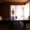 The sleeping and eating area (with tatami mats) of our Japanese-style room in Shimoda at the Shimoda Yamatokan.  Krista is standing just behind the sliding paper door.