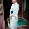Krista wearing a yukata (what most people think is called a kimono).  The hotels provides yukata and slippers for all guests.