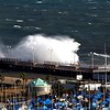 A mighty wave smashes against the Enoshima breakwater.