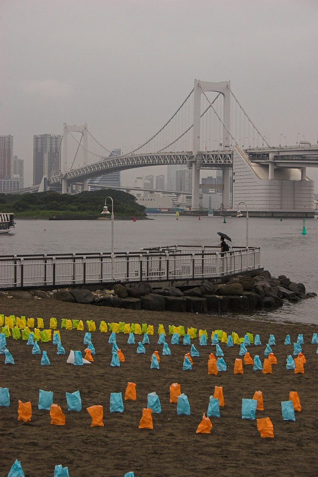 Luminary festival in Tokyo - they created fishes with these colorful bags with lit candles in them.