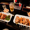 Yakitori, various foods grilled on skewers, is Japanese pub food. Here, left to right, we think we had: chicken meatballs, chicken skin, white chicken meat, chicken liver, ????, peppers, pork belly, chicken wings, white chicken meat, leeks, chicken meat balls.