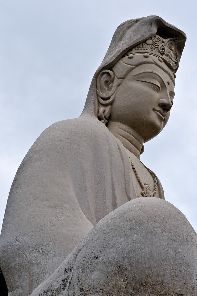 Buddha in serene meditation, main statue of the Ryozen Kannon WWII Memorial Shrine, Kyoto, Japan.  As seen up close.