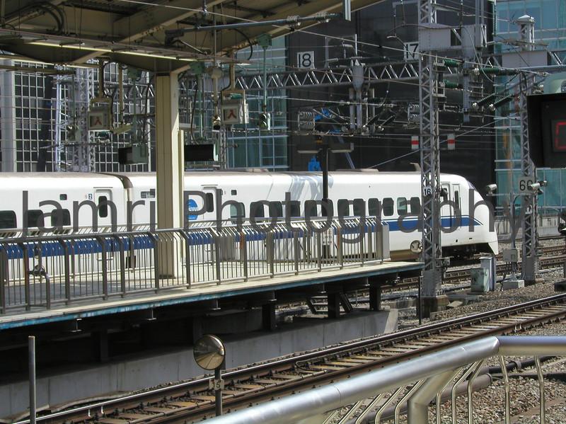 Train Departing Tokyo, Tokyo, Japan