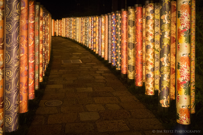 Lighted tubes lined with patterned kimono cloth, at Randen-Arashiyama station in Kyoto.
