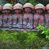 Bhuddist Jizo statues which are often viewed as protectors of children and travelers.  People often knit red caps and bibs for them.