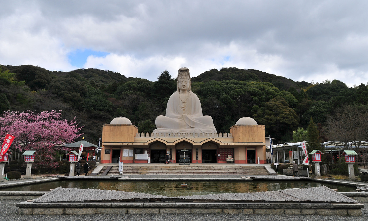 Buddha in serene meditation, main statue of the Ryozen Kannon WWII Memorial Shrine, Kyoto, Japan.