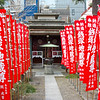 Red flags leading to a small shrine on the grounds of Senso-ji Temple, in Asakusa, Tokyo