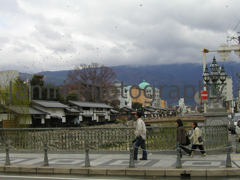 Crossing over a bridge, Matsumoto, Nagano-ken, Japan