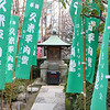 Green Flags leading to small shrine at the Senso-ji Temple in Asakusa, Tokyo