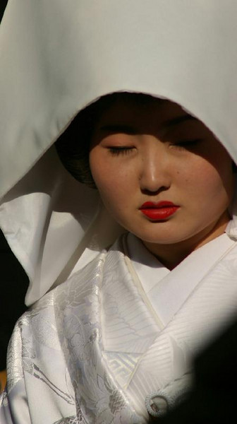 The bride at a traditional Shinto wedding at the Kamakura Hachimanju shrine.