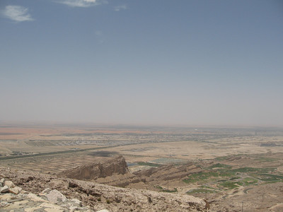View down to the plains from the mountain.  Somewhere on the road running through the middle of the picture is the border with Oman.