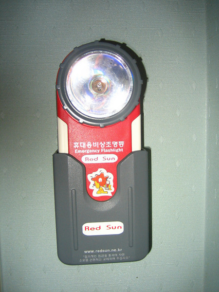Emergency flashlight in my hotel room. Nice. (But I travel with my own.)