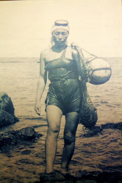 Old picture of a woman diver. I'm pretty sure they dove for abalone.