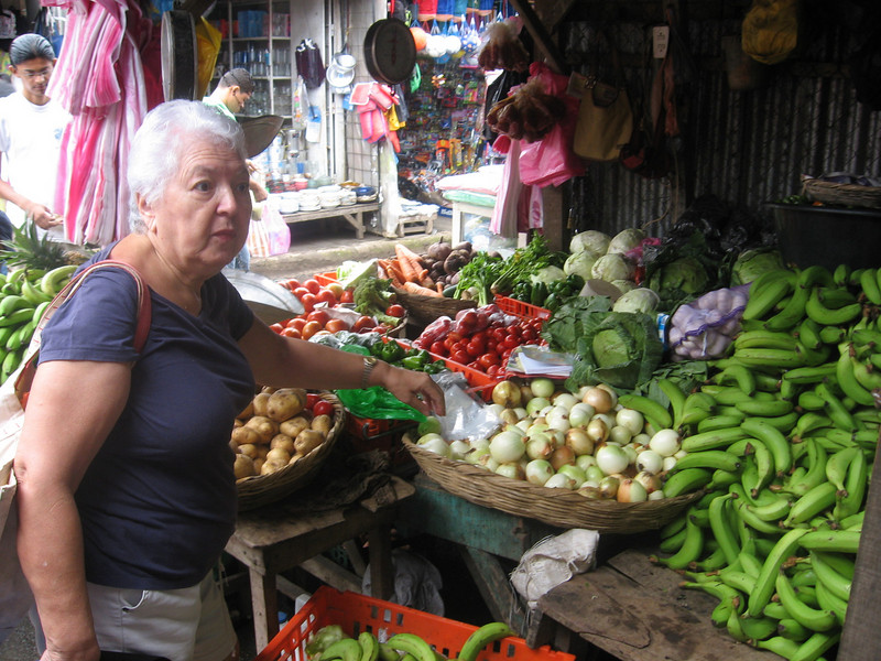 vegetables and fruits are incredible cheap here. This is Mom buying onions and tomatoes.
