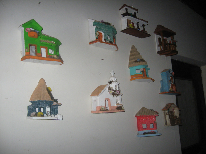 "a wall decorated with ""casitas"""