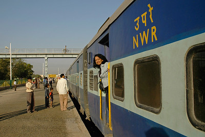 Anu (Arundhathi) at the door of the train which stopped briefly at the Paumarwar railway station enroute to the Rajasthan trip in the train to Jodhpur, Rajasthan, Western India.