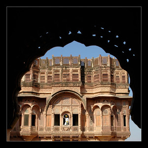 Attendants inside Mehrangarh Fort, Jodhpur. Jharokhas (windows) of the Mehrangarh Fort, Jodhpur. The palace apartments house a splendid collection of the trappings of the Indian royalty. The fort is visited by thousands of tourists every year who come to have a glimpse of the artillery system of the Rajput warriors. One can have a bird's eye view of the city from the fort. Jodhpur, Rajasthan, Western India. The fort has seven gates of which the noted ones are the Jayapol, built by Maharaja Man Singh in 1806; Fatehpol or the Victory Gate built by Maharaja Ajit Singh; and the Lohapol or the Iron Gate. The fort is situated at an altitude of about 125 metres, the Mehrangarh Fort is spread over an area of 5 sq. km in the heart of the city. Jodhpur, Rajasthan, Western India.