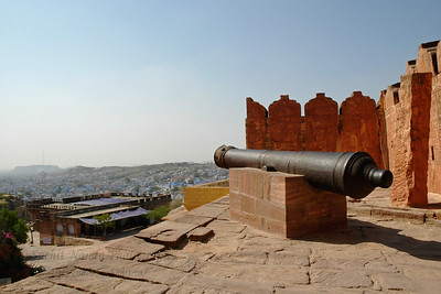 Canons seen from Mehrangarh Fort, Jodhpur which is situated at an altitude of about 125 metres, the Mehrangarh Fort is spread over an area of 5 sq. km in the heart of the city. The fort has seven gates of which the noted ones are the Jayapol, built by Maharaja Man Singh in 1806; Fatehpol or the Victory Gate built by Maharaja Ajit Singh; and the Lohapol or the Iron Gate. The 15 handprints, the sati marks of Maharaja Man Singh's widows who threw themselves upon his funeral pyre in 1843, can be seen beside the Lohapol. On the wall, one can see the strategically located cannons. Jodhpur, Rajasthan, Western India.