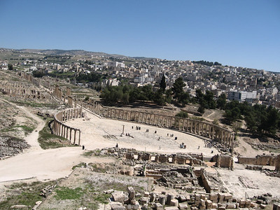 Looking down at the forum in Jerash. The modern town of Jerash is in the background.