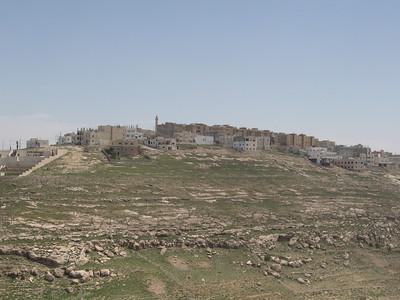 The modern township opposite the castle.