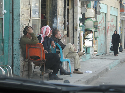 Watching the world pass by - local gents in Karak township.