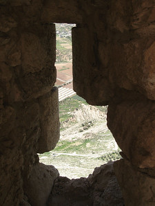 Looking through an arrow slit in the walls of Karak.  Its a really long way down.