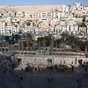 View of Amman and Jabal Al-Q'ala in the background from the top and center of the Roman theater