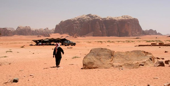Wadi Rum - Bedouin camp at Lawrence's Spring (Abu Aineh), with Jebel Khazali (mountain) in the background.