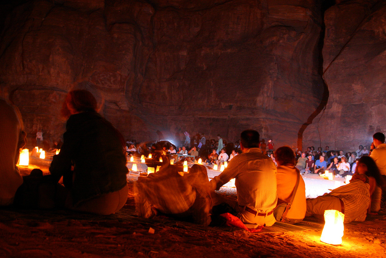 Petra - Petra by Night - Sitting outside the Treasury listening to Bedouin music.  The gap in the rock on the right is the exit of the Siq.