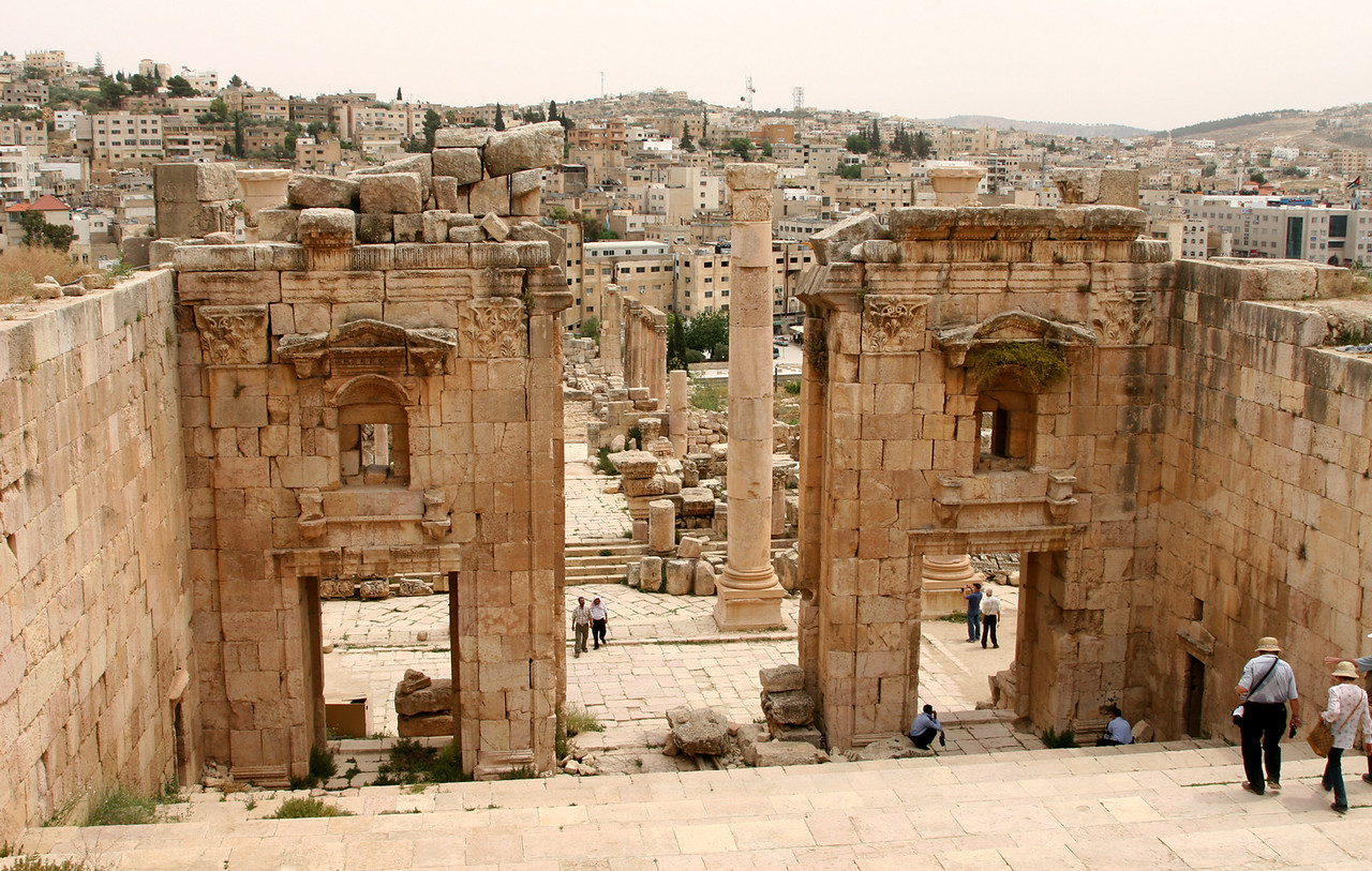 Jerash - The gateway to the Temple of Artemis (up the steps behind the camera), with  modern-day Jerash in the background.