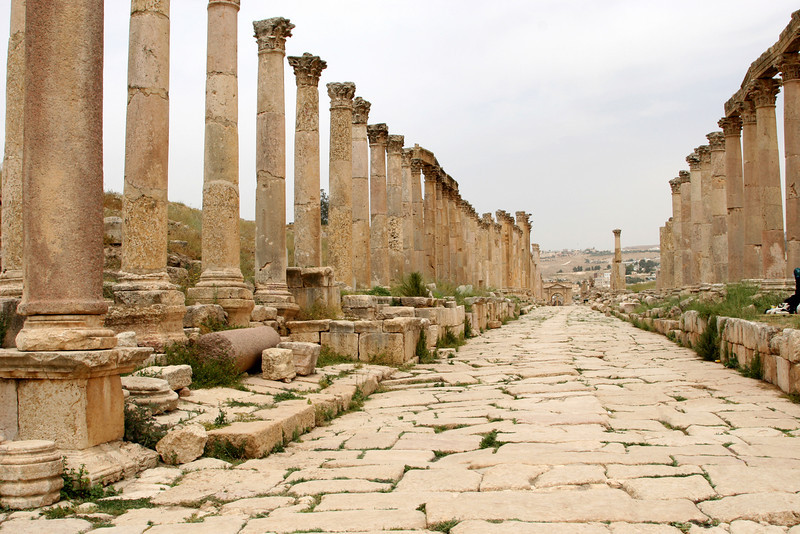 Jerash - The Cardo Maximus (or colonnaded street), the city's main north-south thoroughfare extending from the North Gate (seen in the distance) to the Oval Plaza.  Some of the 500 columns that once lined the street were deliberately built at different heights to complement the facades of the buildings (shops) that once stood behind them.