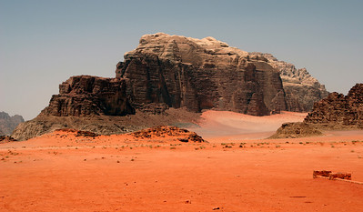 Wadi Rum - Jebel Umm E'jil (mountain range), with the red sands of Wadi Rum.
